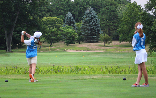 Maggie & Sami watch the tee shot fly in their win over Ridgewood this past Saturday